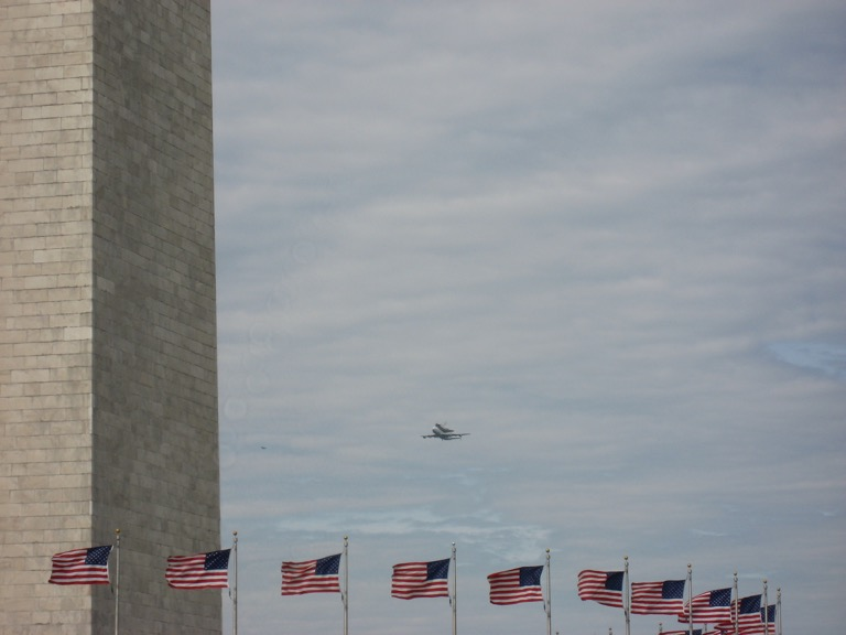 Discovery approaching the Washington Monument