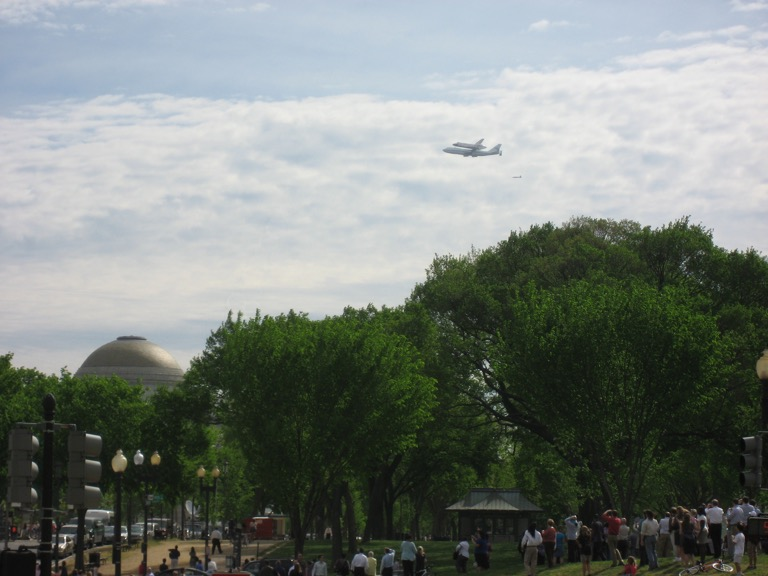 Discovery over the National Museum of Natural History.