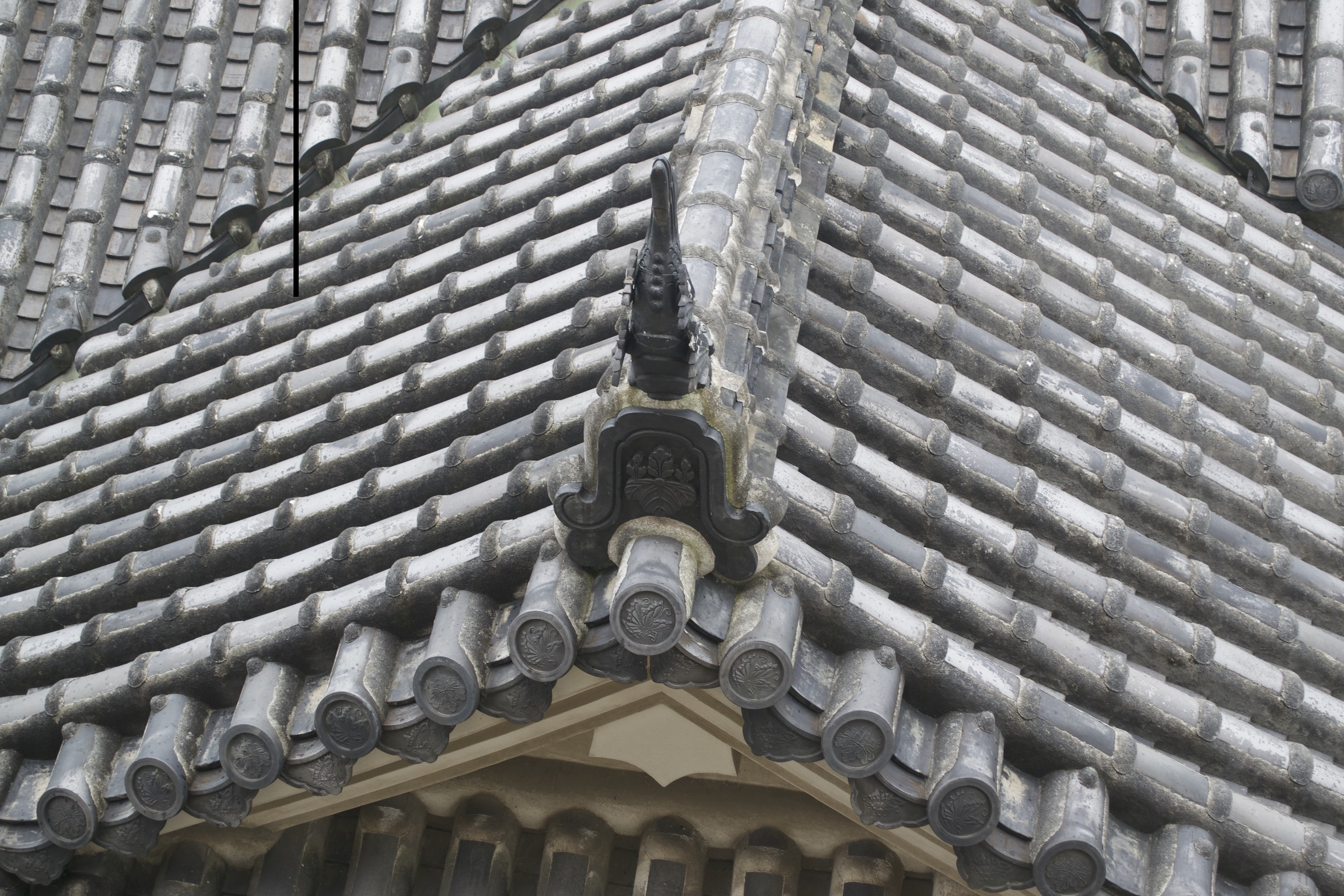 Hand-made cylindrical cermaic tiles cover a roof.